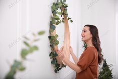 Woman decorating mirror with eucalyptus branches at home. Buy Creativity & Imagination. Take a look at what the world's best photographers have to offer at africa-images.com Eucalyptus Branches, What The World, Best Photographers, Photo Library, Imagination, Creativity, Africa, Take That, Stock Photos