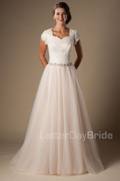 Belleview | Modest Wedding Dress with Sleeves | LatterDayBride | LDS Bridal Gown | SLC | Utah | Worldwide Shipping | Dreamy tulle and a bow at the back make this A-line gown truly delightful.     Gown available in Ivory/Silver, White/Silver or Champagne/Ivory/Silver    *Gown pictured in Champagne/Ivory/Silver