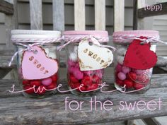 {sweets for the sweet} layered candy mason jars. ITEMS YOU NEED: mason jars, spray paint, Valentine peanut M (or other red, pink and; white candy), carsdstock, letter stamps, Distress Ink, baker's twine/jute/ribbon DIRECTIONS: Fill the jar with M/candy, layering the colors as you go. Two bags of M filled these 3 jars, with a few leftover.