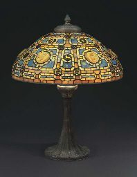 Tiffany Studios  A 'ZODIAC' LEADED GLASS, TURTLEBACK TILE AND BRONZE TABLE LAMP, CIRCA 1910