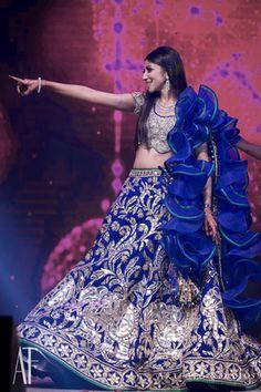 Bridal Details - Karthik & Upasana wedding story | WedMeGood | Silver and Blue Abu Jani and Sandeep Khosla Outfit with a Ruffled Dupatta  #wedmegood #indianbride #indianwedding #bridal #blue #silver #lehenga #bridaldetails #ruffled