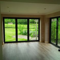 Two aluminum bi-fold doors with amazing views fitted by the Glazedale team! To arrange a free quotation call 01773 712001