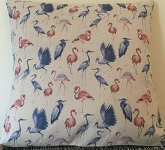 These cushions are handmade with an unusual flamingo and heron pattern, made from a cotton / linen material with an envelope back.  Dimensions: 18 inches wide x 18 inches tall (46cm x 46cm) and 16 inches wide by 16 inches tall (40.5cm x 40.5cm)  Please note that the cushion insert is not included.  Everything is made and stored in clean, smoke and pet-free premises.  Please contact me if you have any questions.  Thanks