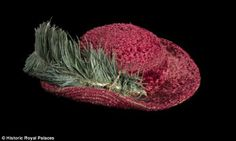 The fluffy red hat, which comes complete with an ostrich feather, will go on display at Hampton Court Palace after being bought for £12,000. It is thought to have been caught after being thrown by Henry VIII in 1544