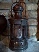 Very old gas lantern turned into electric desk lamp.  It belonged to my husband's grandparents and I converted it as a gift to him.