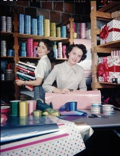 Holiday wrappers at Macy's department store, 1950s.