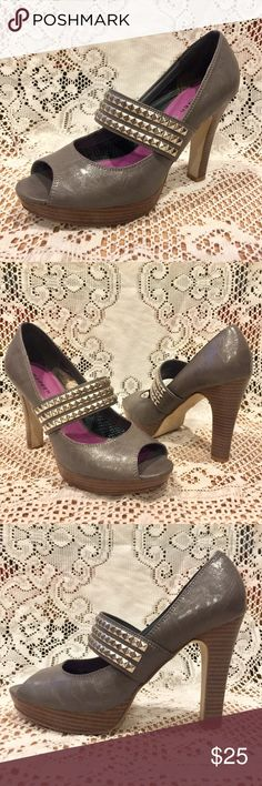 """Madden Girl Grey Studded Peep Toe Heels Madden Girl Grey Peep Toe Heels with silver studs. Strap is attached with elastic for a comfort fit. Faux wood heel and platform. 4"""" heel, 1"""" front platform. Size 8 & fits true to size. These are in wonderful condition! Tags: rocker chic, Steve Madden, vegan leather, gray Madden Girl Shoes Heels"""