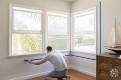 At Home With Orlando: Painting Inside the Lines - Here I am measuring more window borders. This is day two because I'm no longer wearing my neon YOLO t-shirt. by @homepolish New York City
