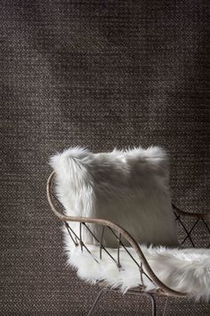Winter gets woolly with a combination of textured rugs and a traditional Javanese handcrafted chair.