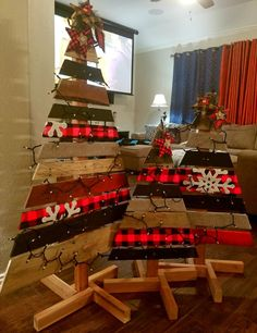 Pallet christmas trees buffalo plaid theme.