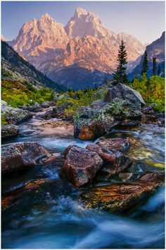Grand Teton National Park, Wyoming. 309,994.66 acres. Grand Teton is the tallest mountain in the Teton Range. The park's Jackson Hole valley and reflective piedmont lakes contrast with the tall mountains which abruptly arise from the glacial sage-covered valley.