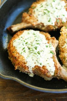 Pork Chops with Lemon Basil Cream Sauce - Juicy crisp-tender pork chops served with the most heavenly cream sauce. Made in 30 min. You can't beat that!