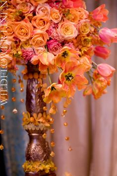Amazing Orange & Yellow centerpiece. I love the height and brightness of this piece.