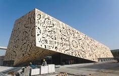 Building covered with laser cut screen
