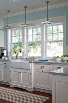 Cottage Kitchen with Standard height, Inset cabinets, Subway Tile, double-hung window, White backsplash, Farmhouse sink