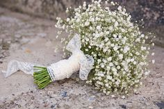 All Gyp bouquet with a lace wrap... ( i would prefer a cream lace) Winter wedding. Affordable beauty.