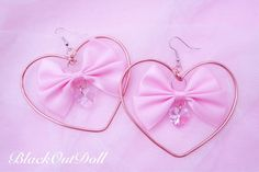 Sweet Heart Hoop Earrings!! Made for the cutest dolls in the world <3 Wire Wrapped with Rose Gold Design into a Heart Hoop Earring with Satin Bow in the center!! Features Crystal Heart Diamond below. Earring Width: 3 inches Earring Length: 3.25 inches