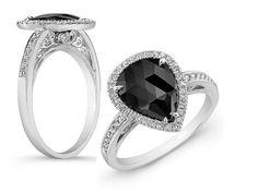# A SINGLE ROSE CUT PEAR SHAPE BLACK DIAMOND ENGAGEMENT RING