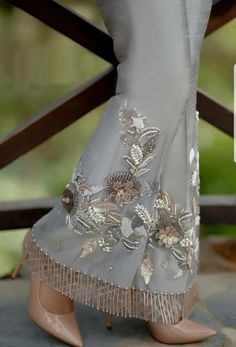 Grey raw silk boot cut trousers with pearl and crystal embroidery and embellishment with crystal hangings. Available to order as boot cut or straight trousers. Pakistani Fancy Dresses, Pakistani Wedding Outfits, Wedding Dresses For Girls, Pakistani Dress Design, Pakistani Fashion Casual, Latest Dress Design, Sleeves Designs For Dresses, Embroidery Dress, Stylish Dresses