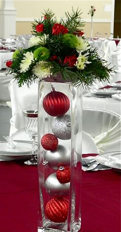 Christmas Table Piece at a December Wedding blue silver White, flowers or red gold, then white flowers @Tracy Arnold