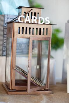 Use an old lantern to hold your wedding cards or small gifts at the reception site. It's a great way to hold your wedding keepsakes together!
