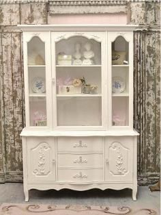 I love how they added embellishments to drawers and doors.