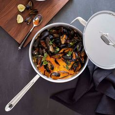 Coconut-Curry Mussels Serves 4 to 6.     2 T canola oil     1/2 c sliced shallots     1 red bell pep diced     1/4 c red curry paste     2 T mince garlic     2 t grated ginger     Pinch red pep flakes     2 can (15 oz.) coconut milk     2 T fish sauce     2 T fresh lime juice     2 lb. mussels, scrubbed     Chopped fresh cilantro for garnish     Lime wedges