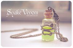 Snake venom bottle Necklace.glow in the dark necklace poison necklace Glass Vial glowing Necklace Glass Bottle glowing pendant gothic door 13thPsyche op Etsy https://www.etsy.com/nl/listing/194116730/snake-venom-bottle-necklaceglow-in-the