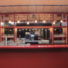 Red bar with bulb lamps and mirror