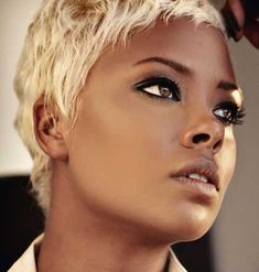 Black Women with Short Hairstyles:  eva Marcille is a well known celebrity [originally know from America's Next Top Model] and she is also a very trendy lady. She looks hot and sexy in this short haircut with a lighter blonde hair color tone.
