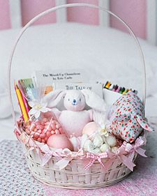 adding ribbon to decorate a basket.