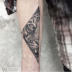 I love the fact this tattoo is a portion of a tigers face in the triangle shape. This is also roughly the place I would like to get a tiger tattoo positioned