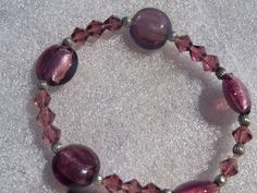 Purple beaded elastic bracelet matching earrings by BeaderBubbe, $15.50