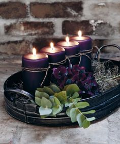 a fall Scandinavian centerpiece of a dark metal tray, purple candles, hay and purple hydrangeas and eucalyptus - DigsDigs Candle Lanterns, Pillar Candles, Candle Tray, Purple Candles, Lavender Candles, Black Candles, Bridal Shower Centerpieces, Centrepieces, Candle Centerpieces