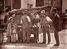 The Seller Of Shellfish: 'Me and my missus are here at the corner with the barrow in all weathers, specially the missus, as I takes odd jobs beating carpets, cleaning windows and working round the public houses with my goods'. London 1870's.
