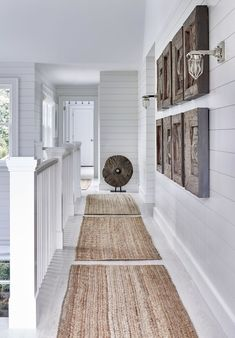 Beach house hallway with durable jute rugs.