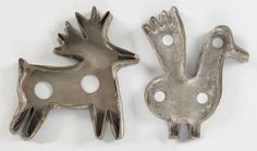 "Two tinned sheet iron cookie cutters, 19th c., to include a stag, 6 1/2"" h., 6 1/2"" w., and a bird."