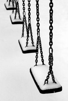 Swings.  The image brings back many good grade school memories.