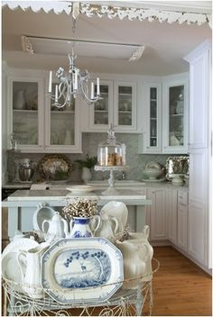 Let's Talk Kitchens - this post has a great collection of kitchens - The Black Rooster Cottage