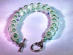Opal Swarovski Light Green Pearl Bracelet by swofinc on Etsy. https://www.etsy.com/shop/swofinc