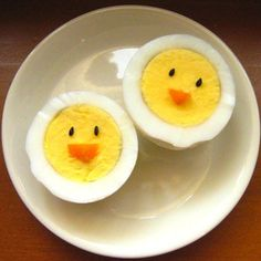 Chirp chirp ~ boiled egg fun.  Beak is a triangle cut of carrot, eyes are black sesame seeds or could use little cuts of a cucumber or eggplant.