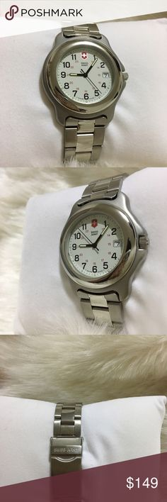 Men's watch This is pre-owned  vintage men's watch. Stainless steel  two tone.  Quartz japan movement.  Watch is vintage but looks like new. 2-3 scratches on the back case at battery changing time. No scratches on crystal. Glass crystal. Approx wrist fit 7.5 inch.  Watch is genuine. And was produced approc 1990's Watch looks like new. swiss army Accessories Watches