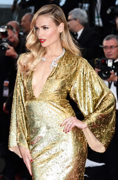 Gilded dress. Glam Hollywood waves. It's go time at Cannes for Natasha Poly.