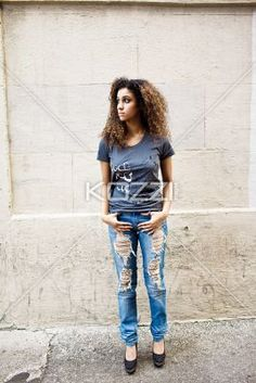 staring off to the side - Staring off to the side, a young woman stands with her thumbs hooked into her jeans.   MUA - Wright Artistry