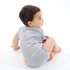 http://shop.teslamotors.com/collections/apparel/products/baby-onesie-zero-emissions-almost-heather-gray