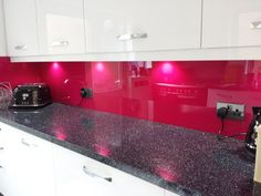 A vibrant, glossy pink splashback that works surprisingly well with the white and granite. Living Spaces Rugs, Outdoor Loveseat, Big Kitchen, Splashback, Rug Cleaning, Kitchen Countertops, Kitchen Accessories, Spice Things Up, Backsplash