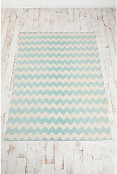 This is a better picture of the aqua chevron rug from Urban Outfitters. Not sure if it's bright enough but it seems like a nice color!