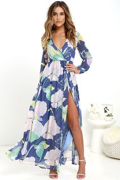 Take a moment to marvel at the sheer beauty of the Wondrous Water Lilies Denim Blue Floral Print Maxi Dress! Lavender, sage green, blush, and denim blue chiffon shapes a surplice bodice framed by sheer long sleeves. A billowing maxi skirt with front slit falls below the elasticized waist for a stunning finish.