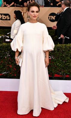 SAG Awards 2017 Best Dressed // NATALIE PORTMAN   wears Dior Haute Couture with puff sleeves and a cape, a bow-accented Christian Louboutin clutch and Tiffany & Co. diamond jewelry.