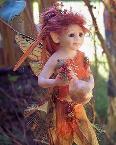 Fall Fairy - Polymer Clay Sculpture with a magical bottle of fall colors. - By Craftystyle